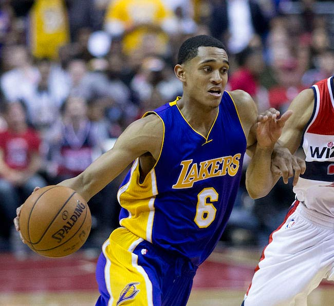 Jordan Clarkson dribbles against Otto Porter of Washington Wizards in a December 2015 match