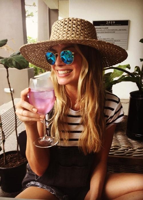 Margot Robbie enjoying her drink in December 2016