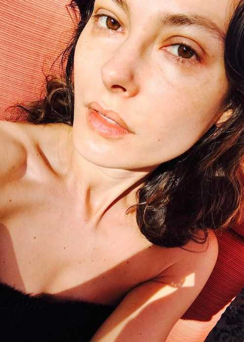 Aurélie Claudel enjoying sun's warmth in Hollywood Hills in March 2017