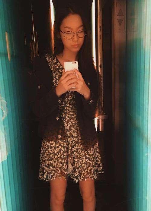 Madison Hu inside an elevator in an Instagram selfie in October 2017