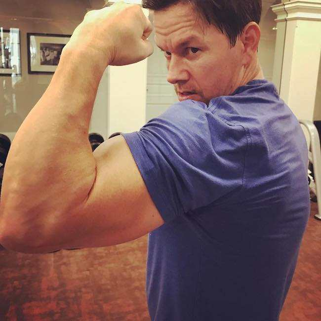 Mark Wahlberg showing his biceps after the Day 1 of training for Mile 22 in August 2017