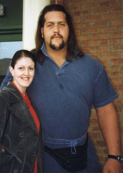 Paul Wight Takes Photographs With a Fan in Sheffield in England During a WWF Tour in April 1999