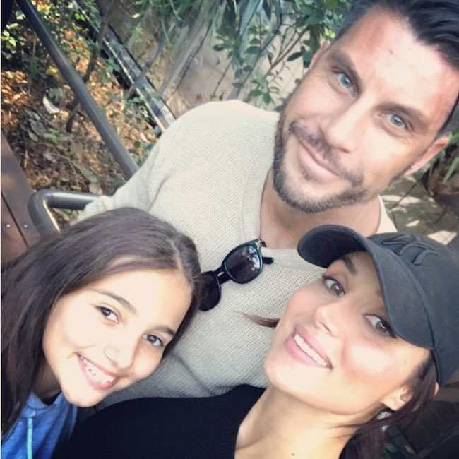 Snezana Markoski with partner Sam Wood and daughter Eve Victoria in August 2017