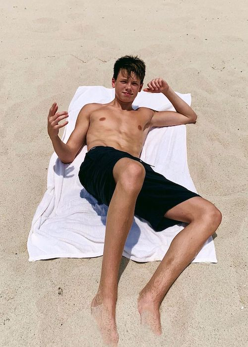 Carson Lueders soaking himself in the Miami sun in June 2019