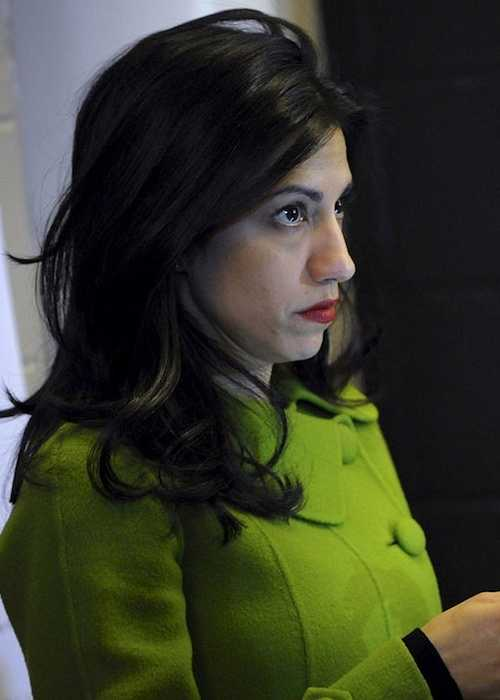 Huma Abedin while checking messages on her phone
