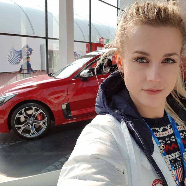 Madison Hubbell in a selfie with a red car on Valentine's Day 2018