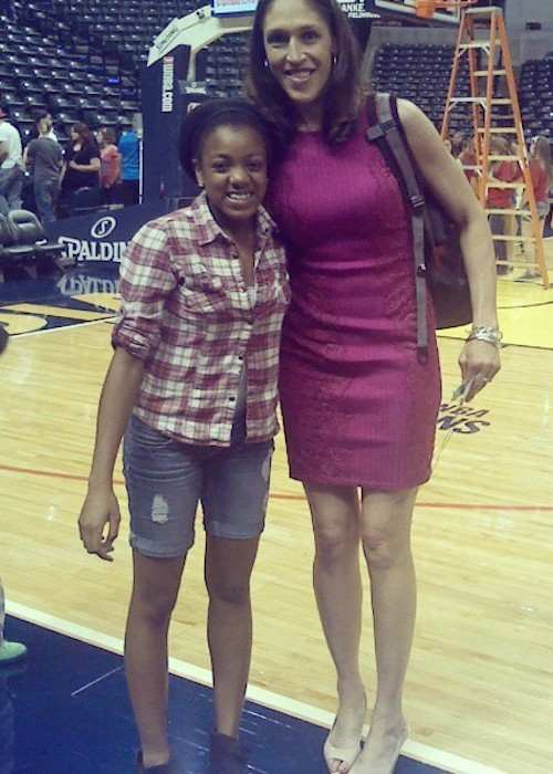 Rebecca Lobo-Rushin with a fan during a basketball game