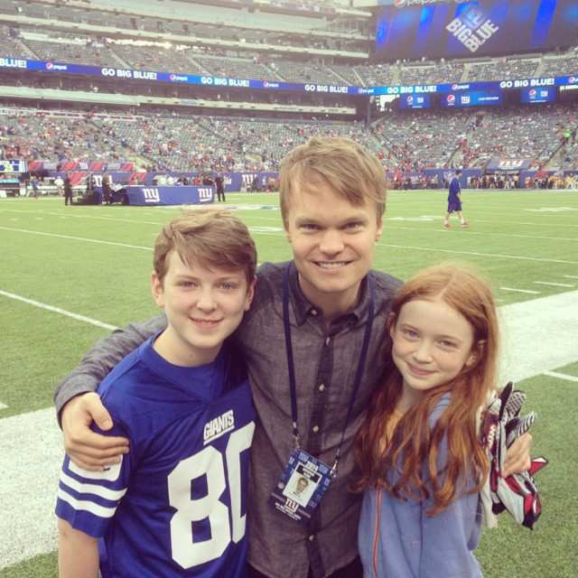 Sadie Sink with brother Mitchell, and agent John Mara Jr. at a football game in 2014 New York Giants vs Houston Texans