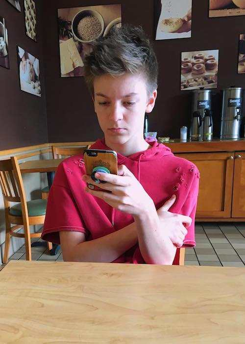 Weston Koury checking his phone as seen in January 2017