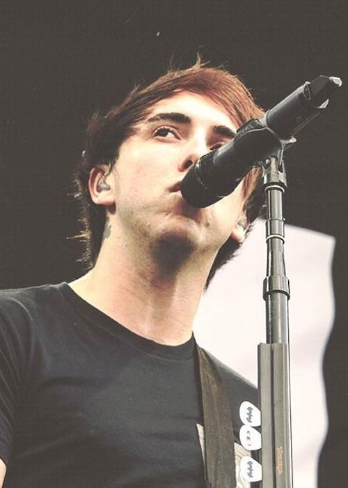 Alex Gaskarth while giving a performance in 2013