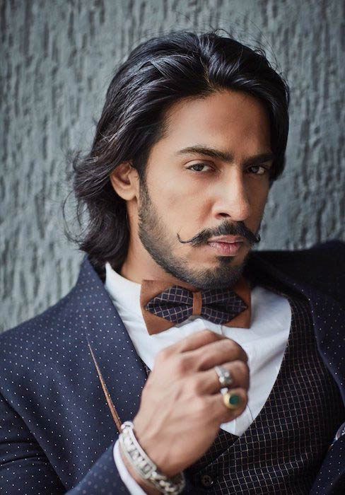Anoop Singh posing for a photoshoot in 2017
