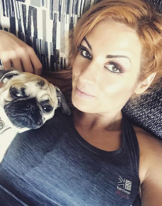 Becky Lynch with her pet pug dog Studley Money as seen in January 2018