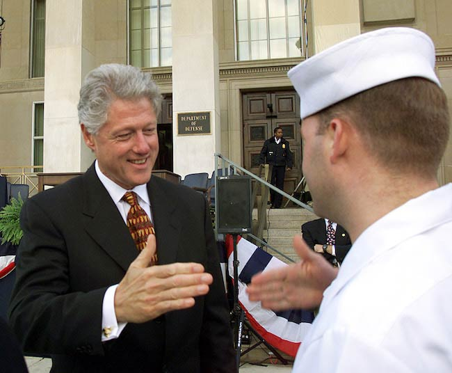 Bill Clinton while shaking hand with U.S. service members in 1999