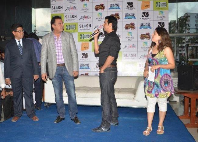 "Boman Irani (in gray coat) and Sharman Joshi promoting their movie ""Ferrari ki Sawari"" in 2012"