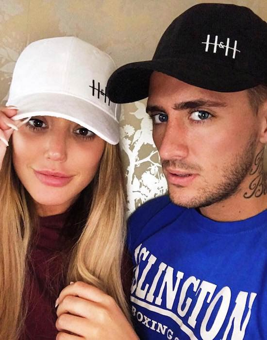 Charlotte Letitia Crosby and Stephen Bear wearing hats from HIS & HERS in June 2017