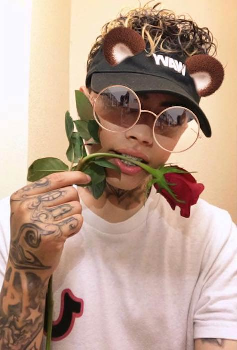 Frimzy offering red rose in a June 2017 picture