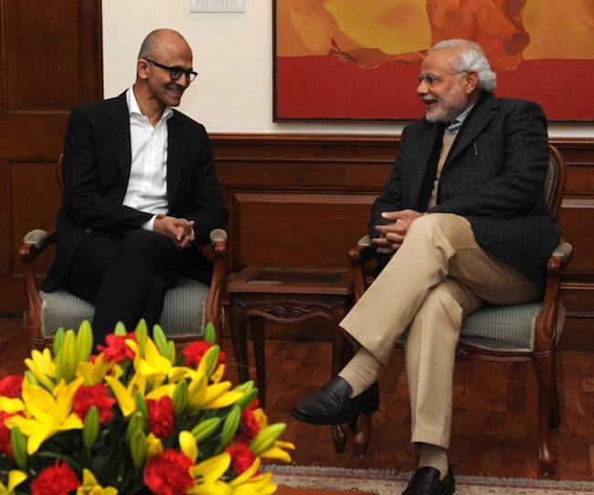 Satya Nadella talking to Indian Prime Minister Narendra Modi in 2014