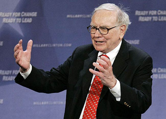 Warren Buffett while addressing people in an old picture