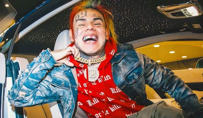 6ix9ine laughing while inside a Rolls Royce car in 2018