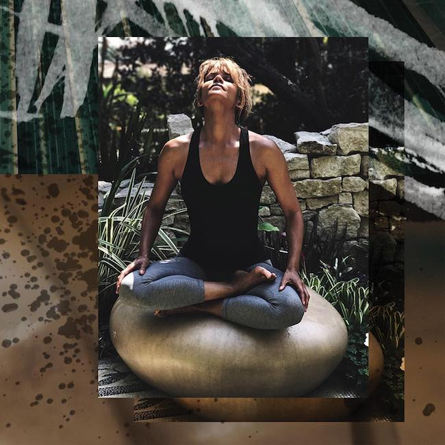 Halle Berry meditating in her home garden in 2018