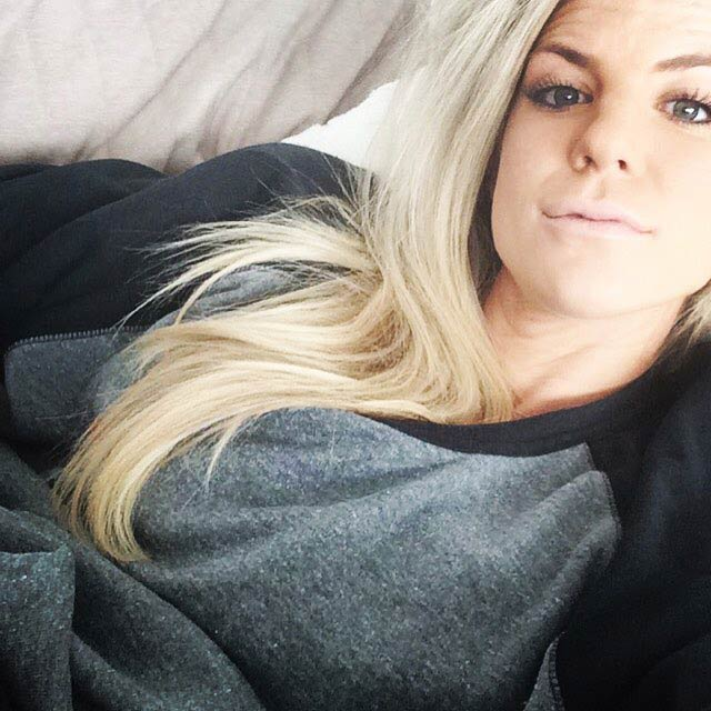 Julie Ertz sitting on a lovesac couch in a selfie in 2015
