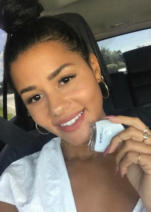 Katya Elise Henry promoting BrighterWhite in a selfie in August 2017