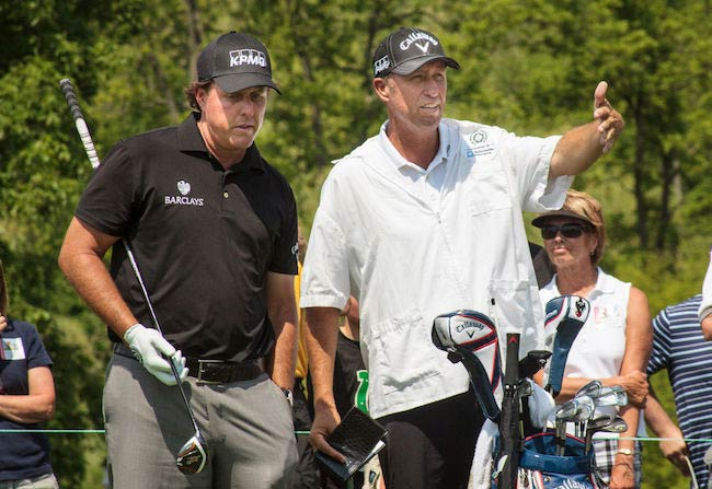 Phil Mickelson talking to his caddy Jim Bones' MacKay at Muirfield Village Golf Club in 2014