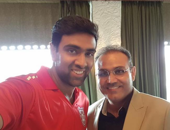 Ravichandran Ashwin with Virender Sehwag in March 2018 after jersey launch of IPL team KXIP