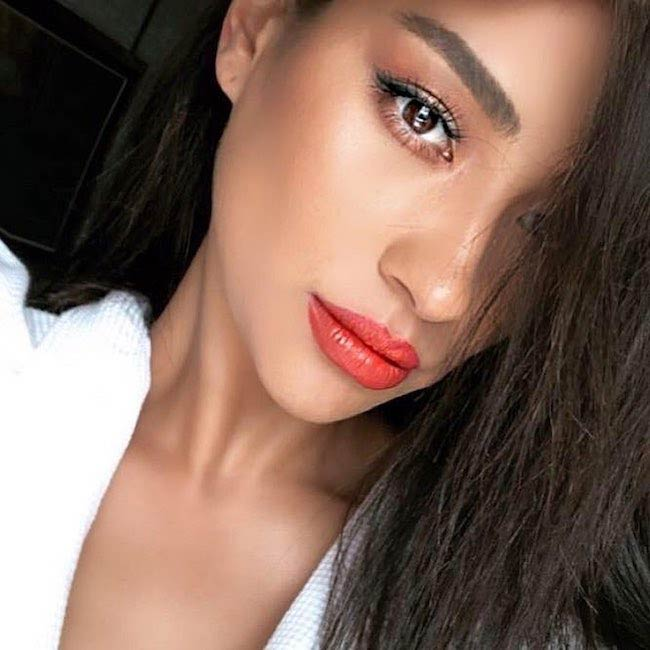 Shay Mitchell showing her face with makeup done in 2018