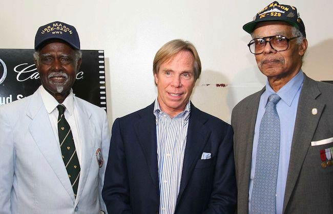 Tommy Hilfiger (Center) with World War II veterans during the screening of play Proud in 2005