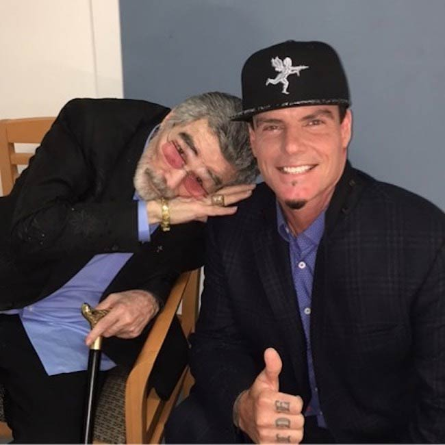 Vanilla Ice and Burt Reynolds posing in April 2018