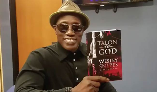 "Wesley Snipes with his book ""Talon of God"" released in 2017"
