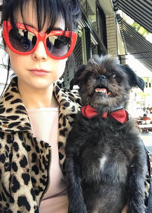 Alessandra Torresani with her dog Pee Wee Herman at Little Dom's in 2018