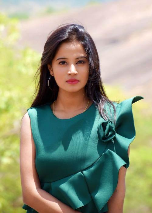 Anusha Rai in green dress during a photoshoot in 2017