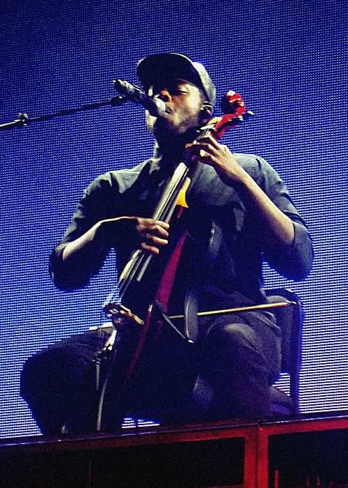 Kevin Olusola performing with Pentatonix in April 2015
