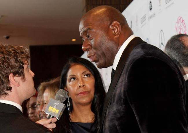 Magic Johnson with wife Cookie Johnson at the Mercedes-Benz Carousel of Hope Gala 2014