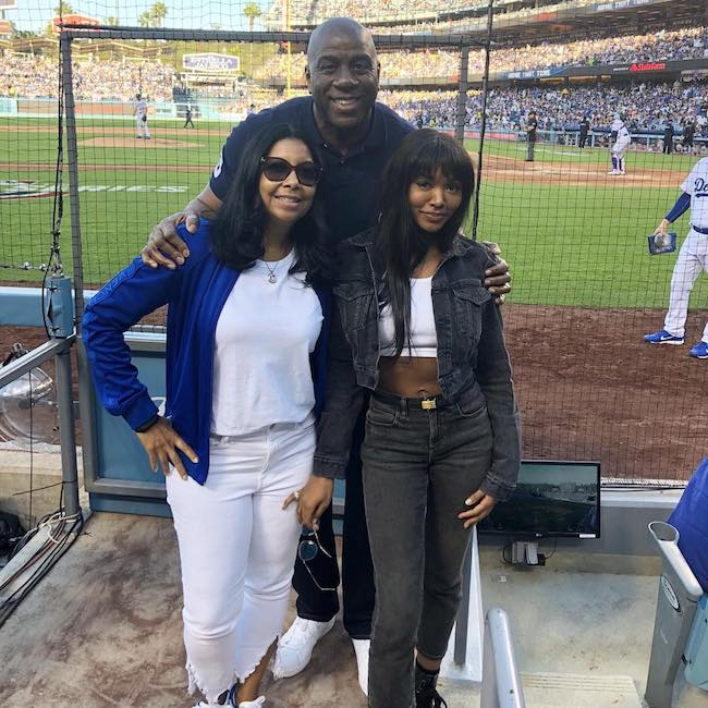 Magic Johnson with wife Cookie Johnson (Left) and daughter Elisa Johnson at the baseball match of Los Angeles Dodgers in 2018