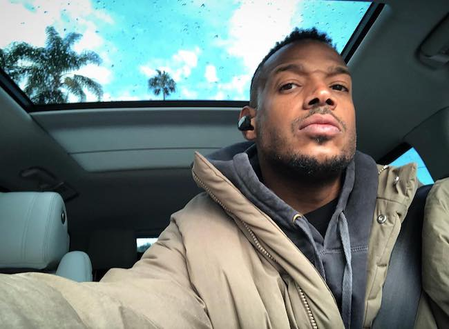 Marlon Wayans inside his car with sunroof open in April 2018