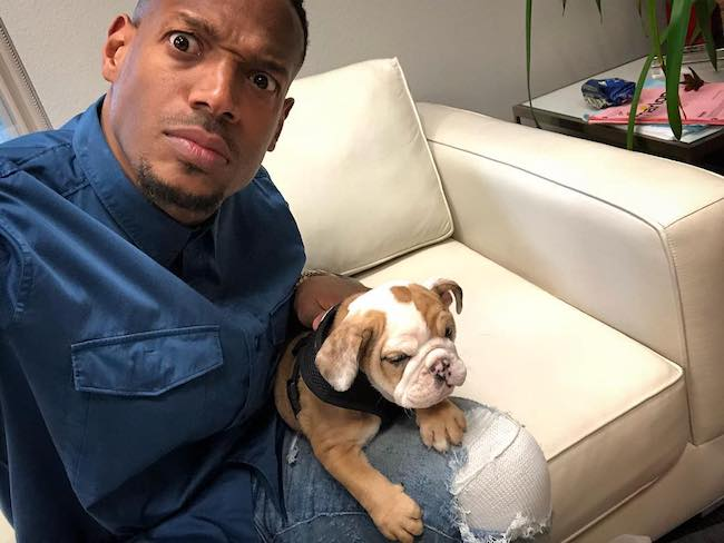 Marlon Wayans with his brother Mike Wayans' puppy in April 2018