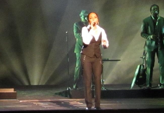 Sade performing with her band at SAP-Arena in November 2011