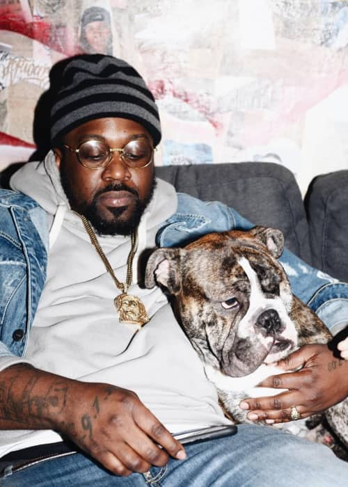 Smoke DZA with his dog as seen in November 2017