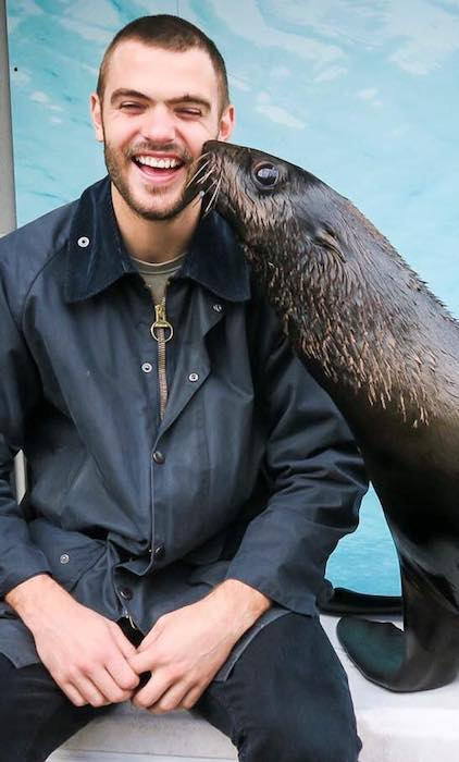 Alex Roe enjoying his time with a seal in July 2017