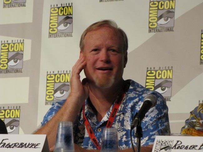 Bill Fagerbakke sitting on the SpongeBob SquarePants panel at the San Diego Comic-Con in 2009