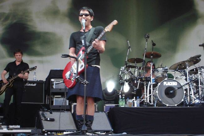 Brian Molko performing in skirt in 2007