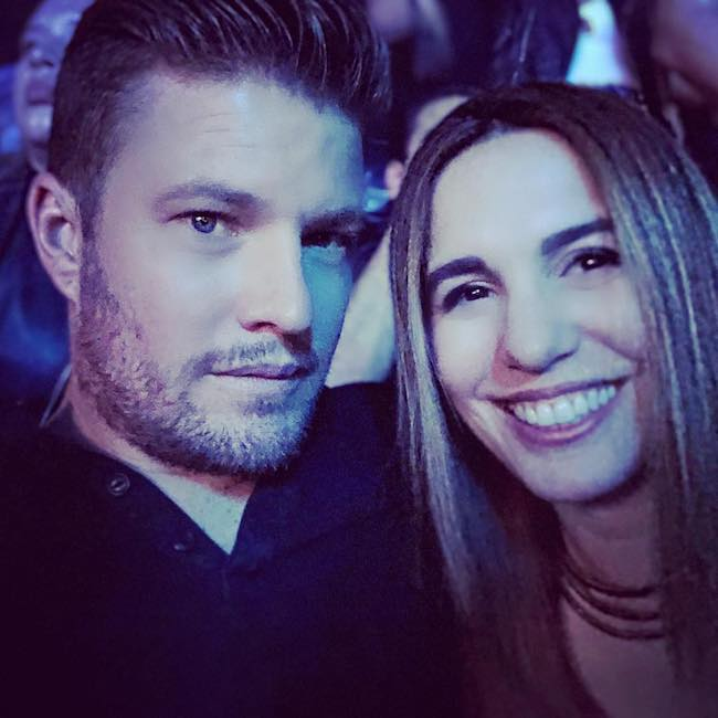 Christy Carlson Romano with her husband Brendan Rooney at Honda Center in May 2018