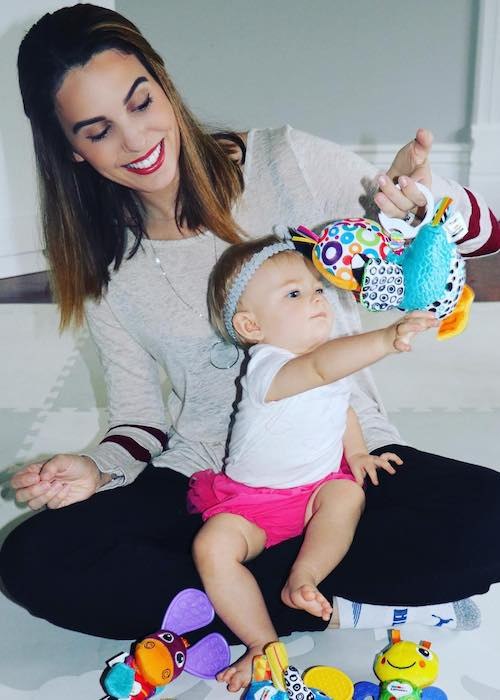 Christy Carlson Romano's daughter Isabella playing with toys in October 2017