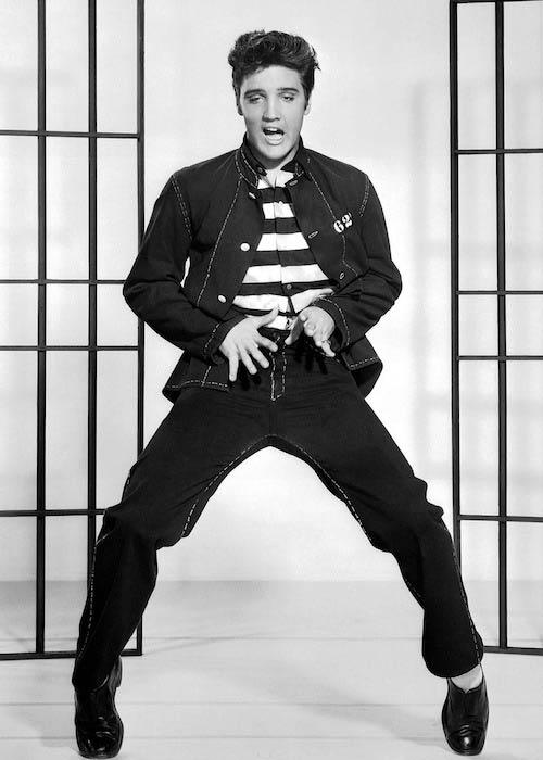 Elvis Presley posing for 1957 film Jailhouse Rock