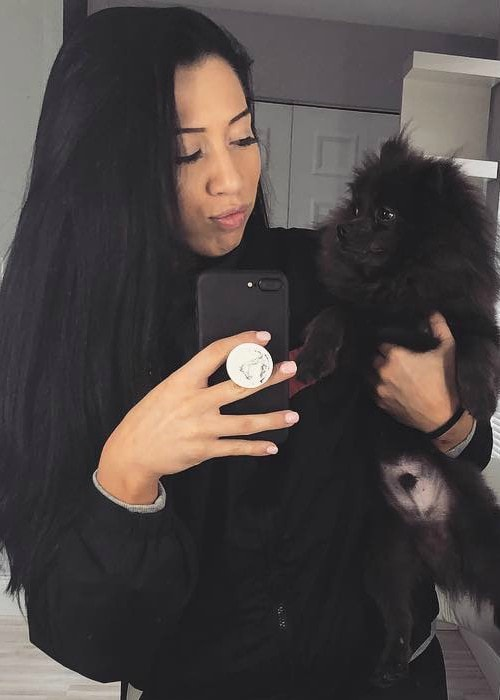 Indi Hartwell in a selfie with her dog in April 2018