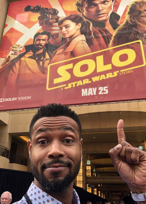 Isaiah Mustafa in a selfie in May 2018 with Star Wars movie poster