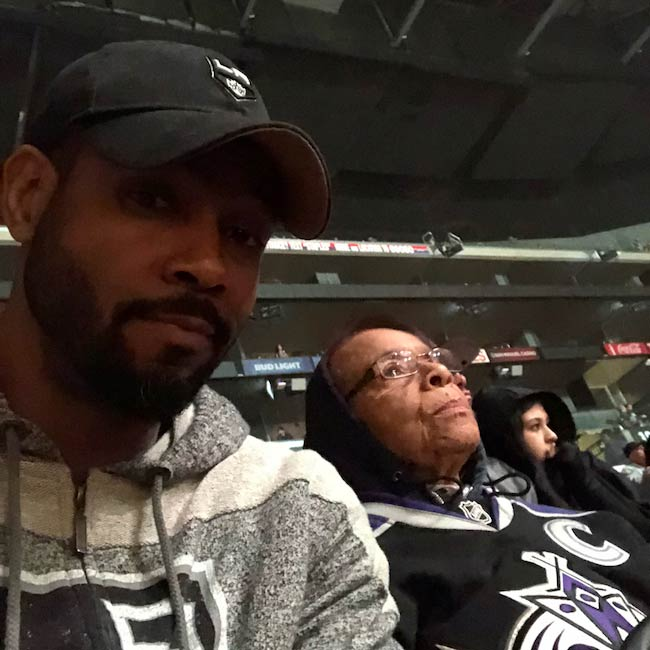 Isaiah Mustafa with his mother watching LA Kings Hockey match in February 2018